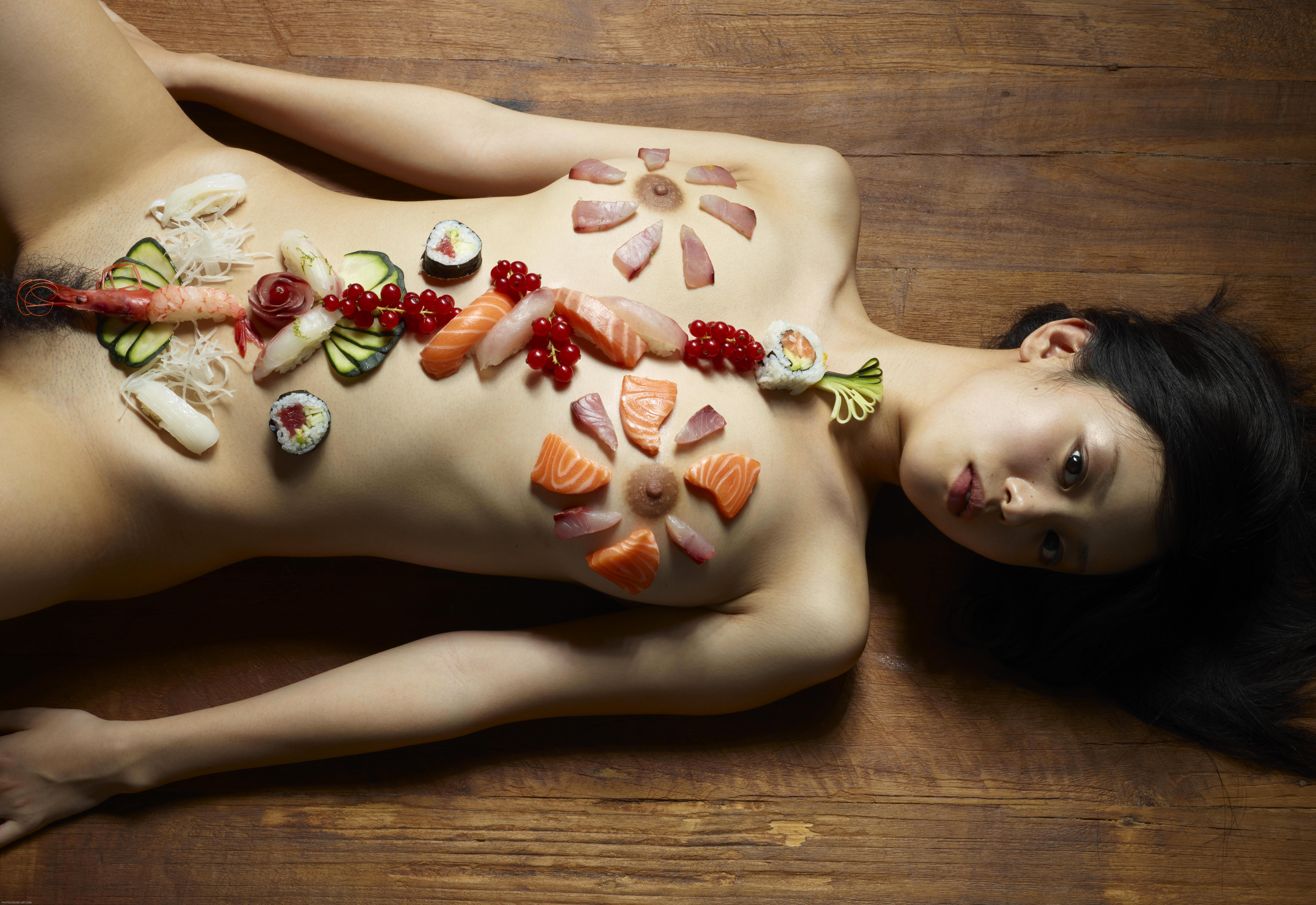 Hegre art konata serving sushi